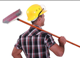 construction worker with broom